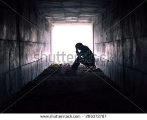 stock-photo-depressed-man-sitting-in-the-tunnel-286372787